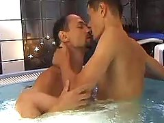 Two infant handsome males frisking in swimming pool