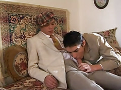 Alluring twink sucks appetizing cock on sofa