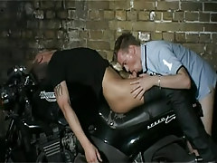 Horny gay stud sucks cock on motorcycle