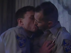 Horny policemen kiss each other